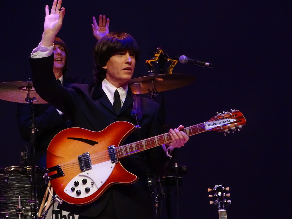 """""""George"""" and """"Ringo"""" encouraging the crowd to get in on the fun."""