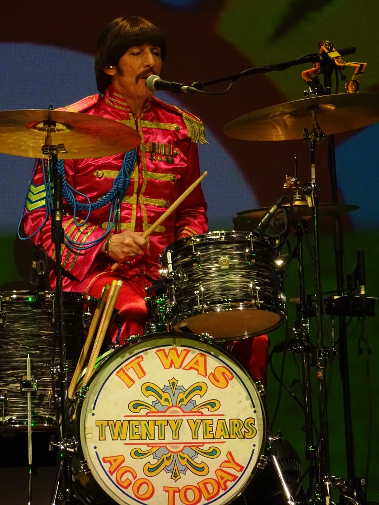 Joe Bologna, as Ringo Starr, getting by with a little help from his friends.